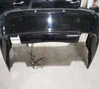Задний бампер мерседес W211 оригинал с неоригинальными парктрониками. Бампер подрезан под выхлоп. На...